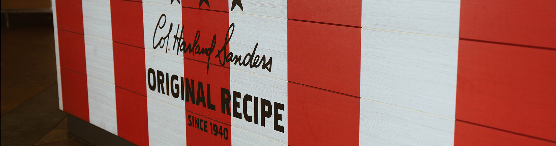 """Red and white wall that says """"Original Recipe"""""""
