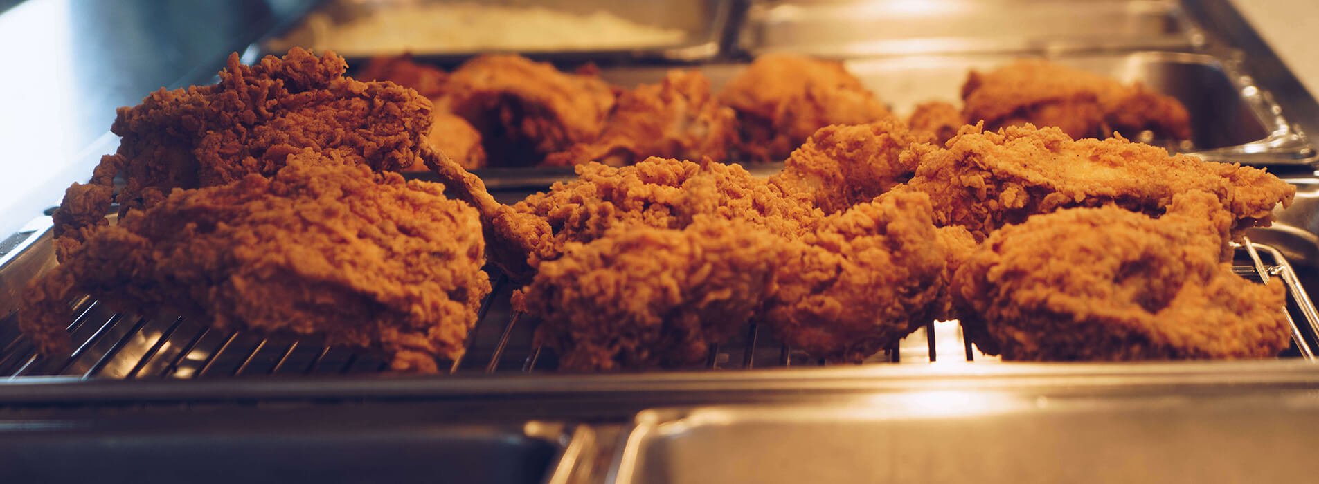 Fried chicken on a heated tray